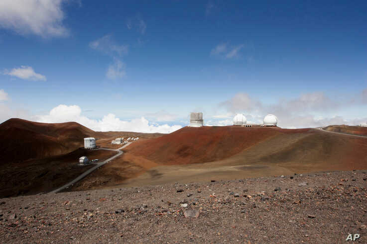 Observatories and telescopes sit atop Mauna Kea, Hawaii's tallest mountain and designated construction site for a new $1.4 billion telescope, near Hilo, Hawaii, Aug. 31, 2015.