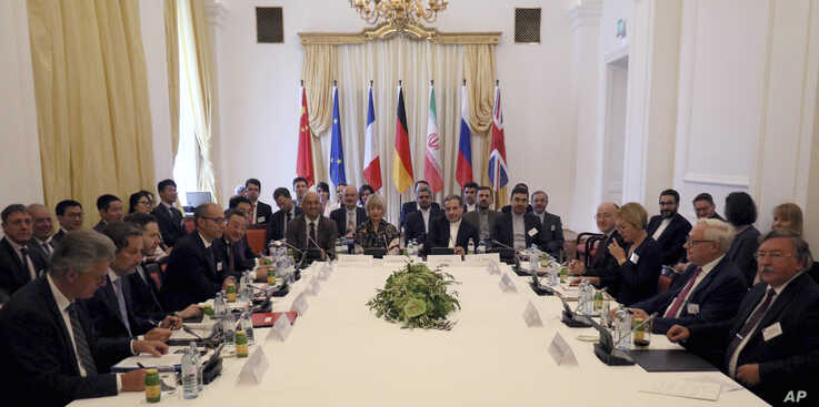 Participants are seen at a meeting held as part of closed-door nuclear talks with Iran, at a hotel in Vienna, Austria, Sunday, July 28, 2019.