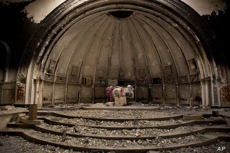 Remnants of an altar are seen in a Catholic church that was gutted by Islamic State militants, in Hamdaniya, Iraq, Dec. 5, 2016.