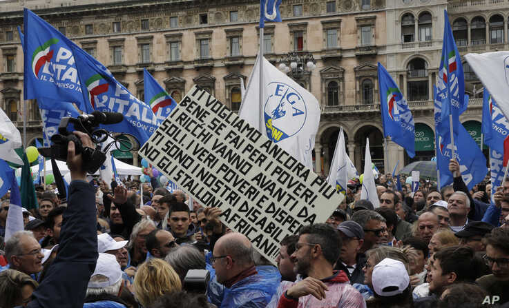 A sign derogatory of African migrants is seen at a rally organized by Lega leader Matteo Salvini, in Milan, Italy, May 18, 2019.