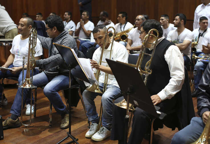 Inmates take their seats as they prepare to take part in a classical music session with the symphony orchestra as part of a pioneering project to rehabilitate criminals in Lima, Peru, July 19, 2019.