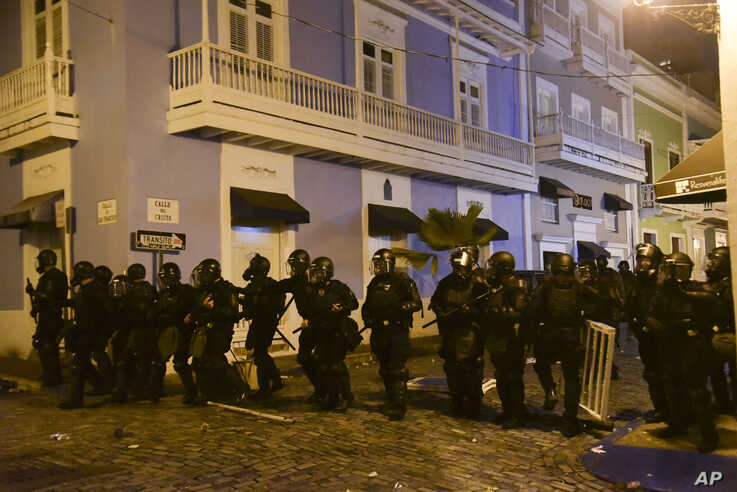 Police units protect the area near the executive mansion from protesters demanding the resignation of Governor Ricardo Rossello, in San Juan, Puerto Rico, July 15, 2019.