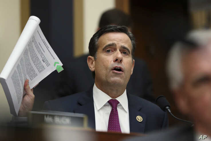 Republican Congressman John Ratcliffe poses questions to former special counsel Robert Mueller, as he testifies before the House Judiciary Committee on his report on Russian election interference, on Capitol Hill, in Washington, July 24, 2019.