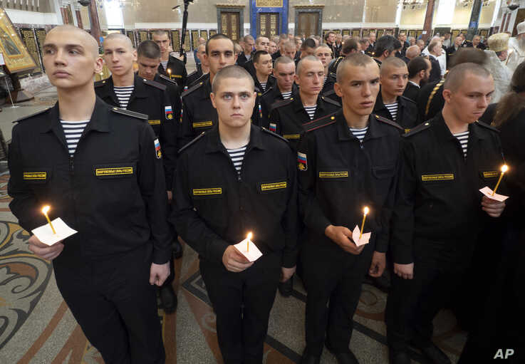 Navy sailors attend a religion service to commemorate the crew members that were killed on one of the Russian navy's deep-sea research submersibles at Kronshtadt Navy Cathedral outside St. Petersburg, Russia, July 4, 2019.