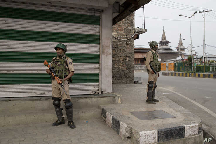Indian paramilitary soldiers stand guard at a market in Srinagar, Indian-controlled Kashmir, July 13, 2019.