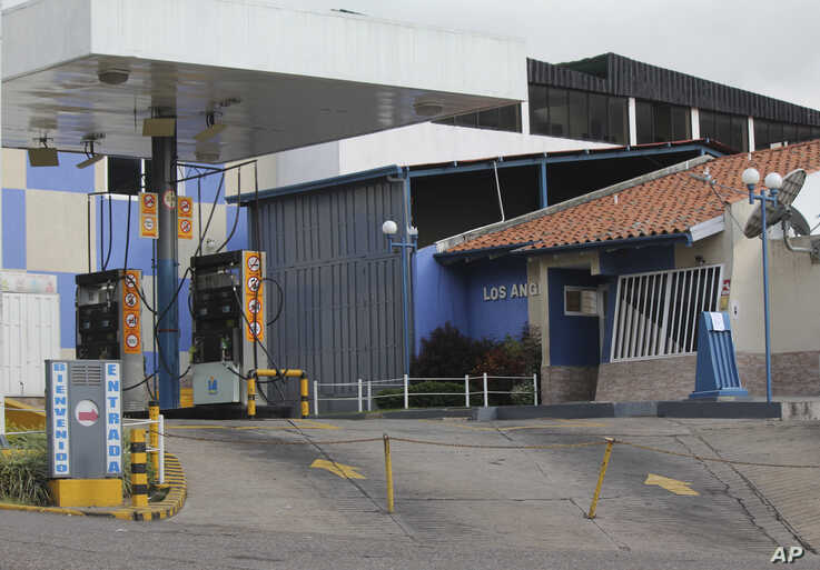 A shuttered gas station due to fuel shortages, in La Grita, Venezuela, June 19, 2019.