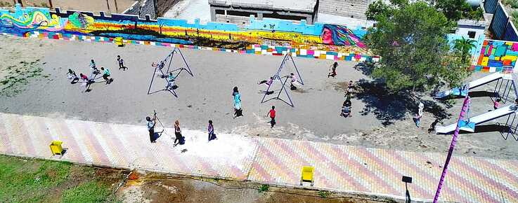 Children are seen playing at a newly-restored playground in Raqqa, Syria, June 25, 2019. (Courtesy photo)