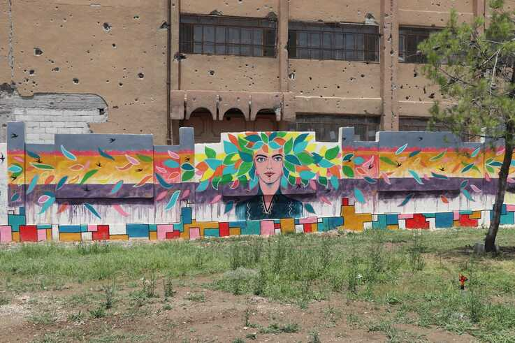 A mural said to be representing diversity is seen on wall at a park in Raqqa, Syria, June 25, 2019. (Courtesy photo)
