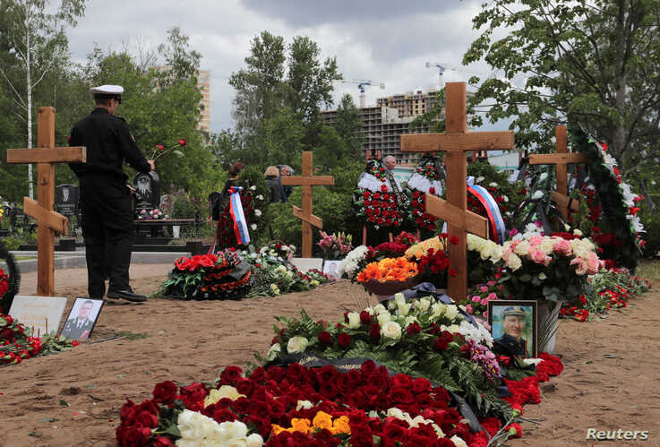 People attend the funeral of Russian sailors, who were killed in a fire on a secret nuclear submersible in the Barents Sea, at Serafimovskoye cemetery in Saint Petersburg, Russia, July 6, 2019.