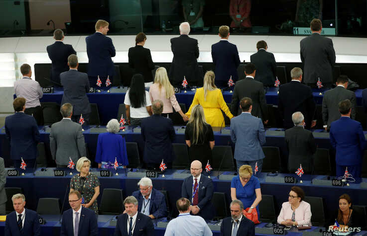 Members of the Brexit Party turn their back to the assembly as the European anthem is played, during the first plenary session of the newly elected European Parliament in Strasbourg, France.