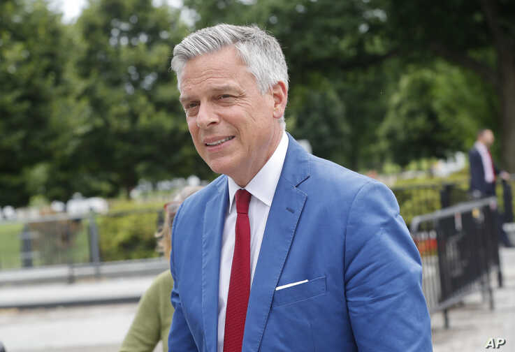FILE - Jon Huntsman, U.S. ambassador to Russia, arrives at the security check point entrance of the White House in Washington, May 30, 2018.