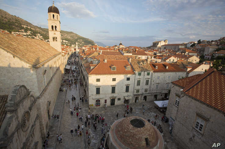 In this Sept. 7, 2018 photo, tourists walk through Dubrovnik. Crowds of tourist are clogging the entrances into the ancient walled city, a UNESCO World Heritage Site, used as a major location for Game of Thrones.