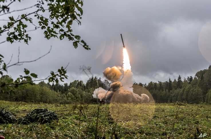 FILE - This undated file photo provided Sept. 19, 2017, by Russian Defense Ministry official web site shows a Russian Iskander-K missile launched during a military exercise at a training ground at the Luzhsky Range, near St. Petersburg, Russia.