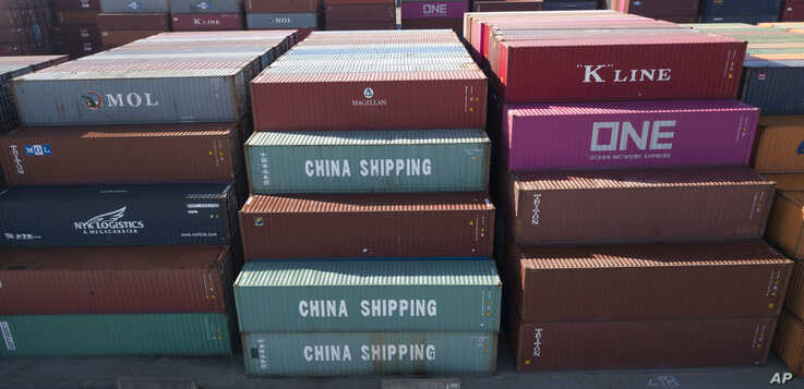 FILE - China Shipping Company containers are stacked at the Virginia International's terminal in Portsmouth, Va., May 10, 2019.