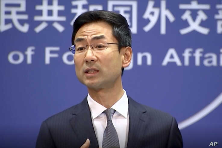 FILE - Chinese Foreign Ministry spokesman Geng Shuang speaks during a media briefing in Beijing in this July 17, 2019, image from video.