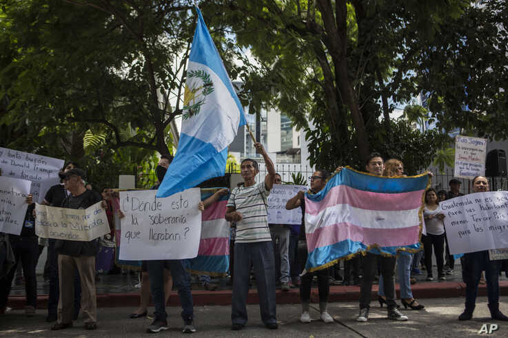 Demonstrators protest a deal Guatemalan President Jimmy Morales' government signed with Washington forcing Salvadoran and Honduran migrants to request asylum in Guatemala instead of the U.S., in Guatemala City, July 31, 2019.