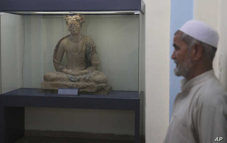 A complete figure of a seated Buddha dating from the third or fourth century is on display at the National Museum of Afghanistan in Kabul, Afghanistan, Aug. 17, 2019.