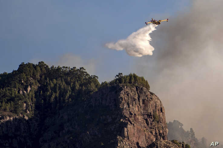 A hydroplane operates on a wildfire in Canary Islands, Spain, Aug. 20, 2019.