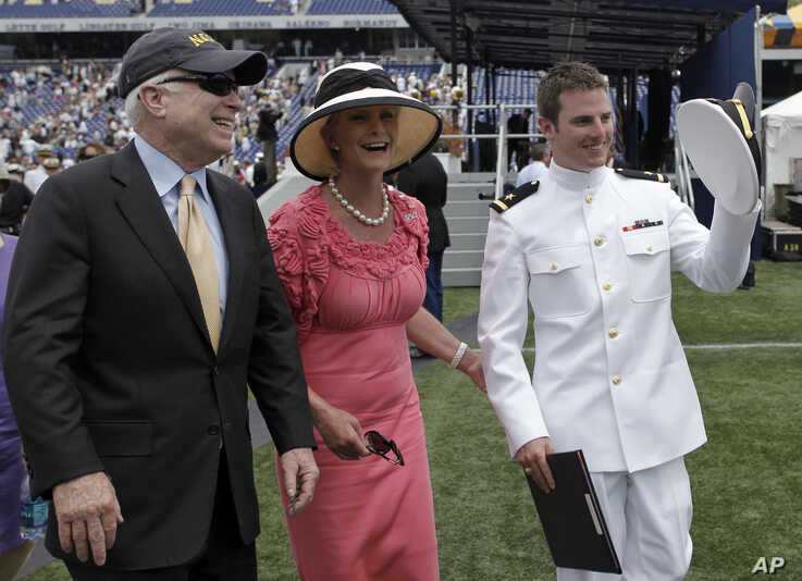 FILE - Sen. John McCain, R-Ariz., left, and his wife, Cindy, walk with their son Jack after he graduated from the U.S. Naval Academy in Annapolis, Md., May 22, 2009.