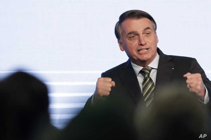 Brazil's President Jair Bolsonaro gestures after his speech to the participants of the Brazilian Steel Congress, in Brasilia, Brazil, Aug. 21, 2019.