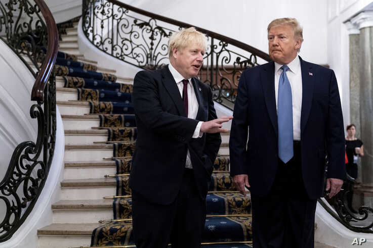 President Donald Trump and Britain's Prime Minister Boris Johnson, left, speak to the media before a working breakfast meeting at the Hotel du Palais on the sidelines of the G-7 summit in Biarritz, France, Aug. 25, 2019.
