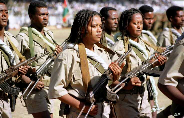 FILE - Young soldiers parade in Asmara during Eritrea's Independence Day celebrations.