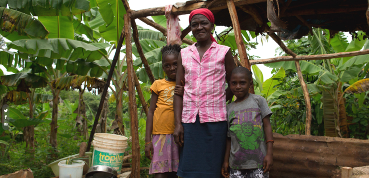 Kore Lavi participant Marie Anna Jolicoeur, a widowed farmer and two of her five children. (Photo: USAID)