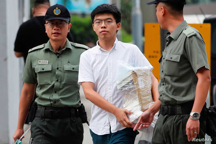 Former student leader Joshua Wong walks out from prison after being jailed for his role in the Occupy Central movement, also known as ìUmbrella Movementî, in Hong Kong, June 17, 2019.