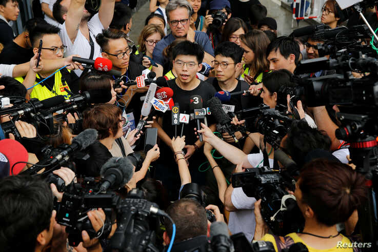 Pro-democracy activist Joshua Wong talks to the media outside the Legislative Council during a demonstration in Hong Kong, June 17, 2019.