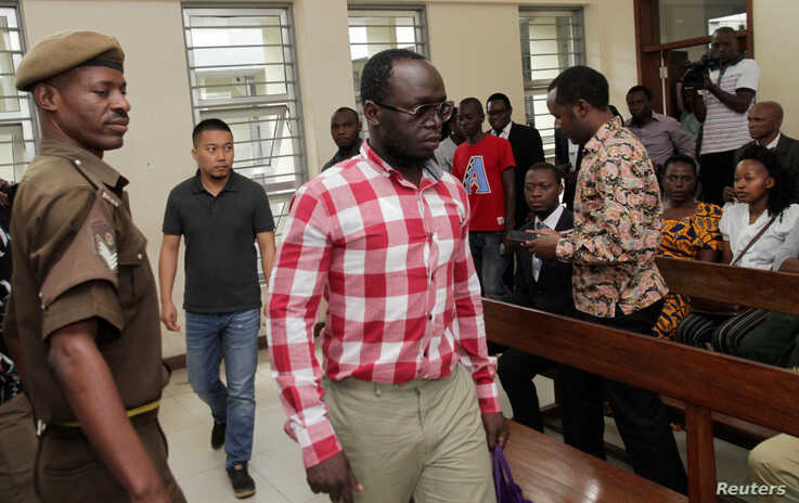 Tanzanian investigative journalist Erick Kabendera arrives at the Kisutu Residents Magistrate Court in Dar es Salaam, Tanzania, Aug. 19, 2019.