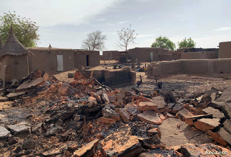 FILE - A general view shows the damage at the site of an attack on a village in Mali, June 11, 2019.