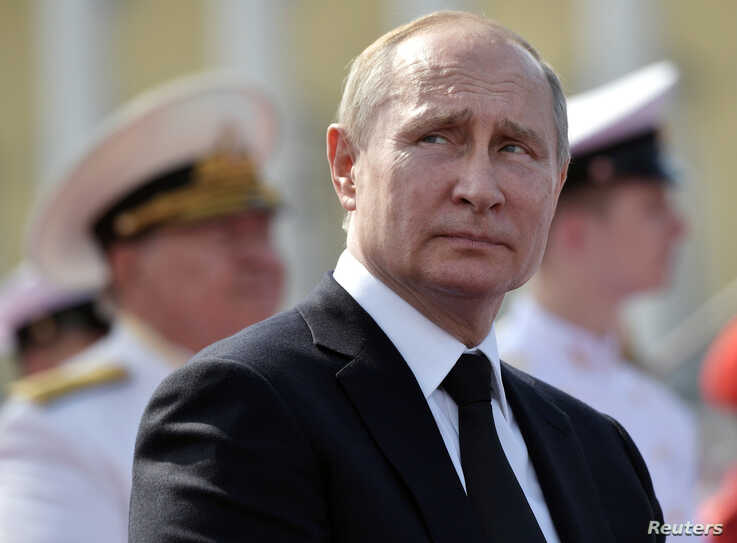 FILE - Russian President Vladimir Putin attends the Navy Day parade in Saint Petersburg, Russia, July 28, 2019.