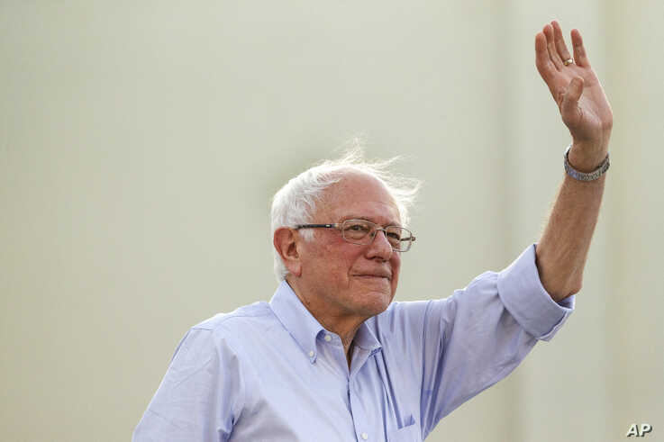 Democratic presidential candidate Sen. Bernie Sanders, I-Vt., waves to supporters as he arrives at a rally at Santa Monica High School Memorial Greek Amphitheater in Santa Monica, Calif., July 26, 2019.