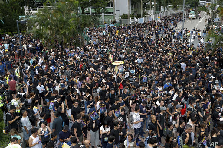 Protesters gather at Po Tsui park as they take part in the anti-extradition bill protests march in Hong Kong, Aug. 4, 2019.