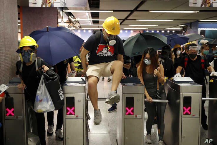 Protesters exit the Causeway Bay MTR station as they proceed to the anti-extradition bill protest destination, in Hong Kong, Aug. 4, 2019.