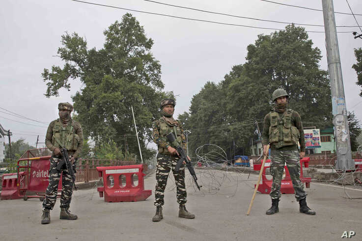 Indian paramilitary soldiers stand guard near a temporary check post in Srinagar, Indian-controlled Kashmir, Aug. 15, 2019.