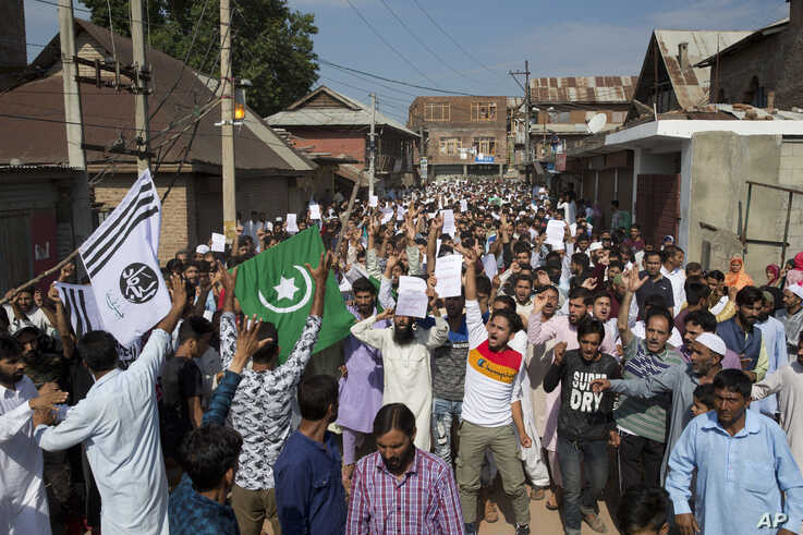 Kashmiri Muslims shout slogans during a protest after Eid prayers during a security lockdown in Srinagar, Indian-controlled Kashmir, Aug. 12, 2019.