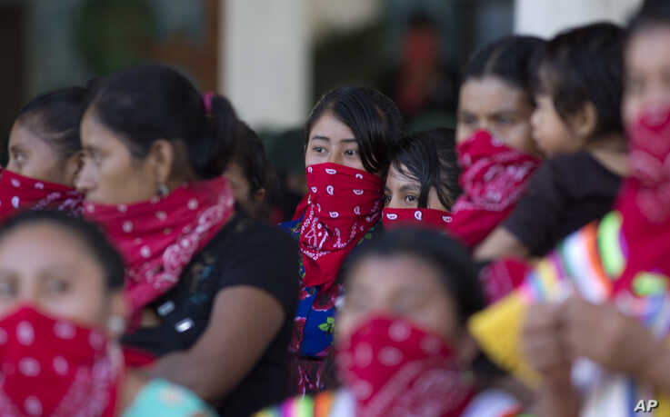 Members of the Zapatista National Liberation Army, EZLN, attend an event marking the 25th anniversary of the Zapatista uprising in La Realidad, Chiapas, Mexico, Jan. 1, 2019.