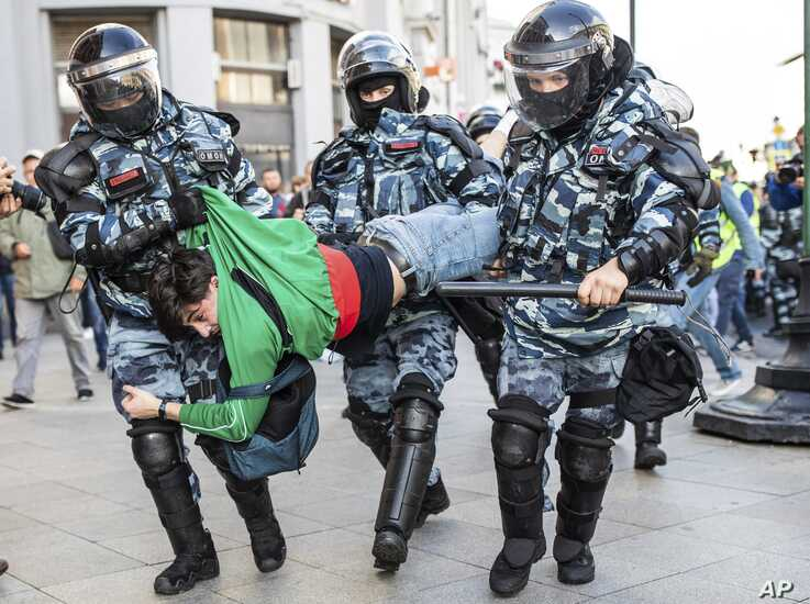 Police detain a man during a protest in Moscow, Russia, Aug. 10, 2019.