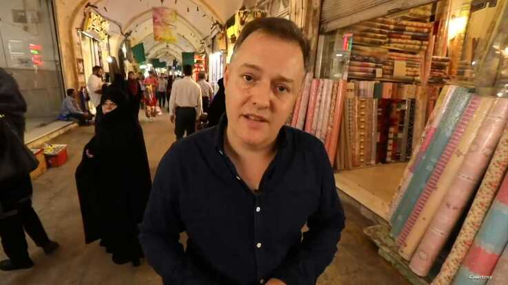 BBC correspondent Martin Patience reports from an Iranian bazaar in this screen shot of a BBC News TV report published on YouTub