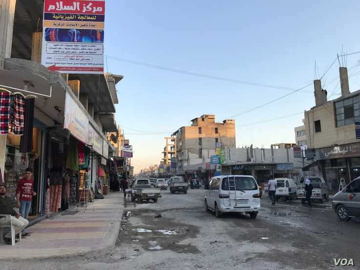Raqqa's main marketplace has partially been rebuilt after the main battle to liberate the city, in Raqqa, Syria, July 20, 2019. (S. Kajjo/VOA)