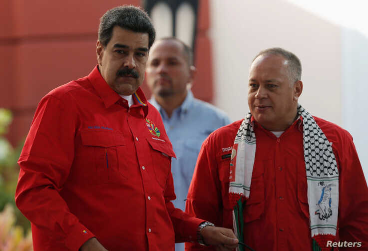 Venezuela's President Nicolas Maduro (L) and President of Venezuela's National Constituent Assembly Diosdado Cabello are seen during a meeting of the Sao Paulo Forum in Caracas, Venezuela, July 28, 2019.