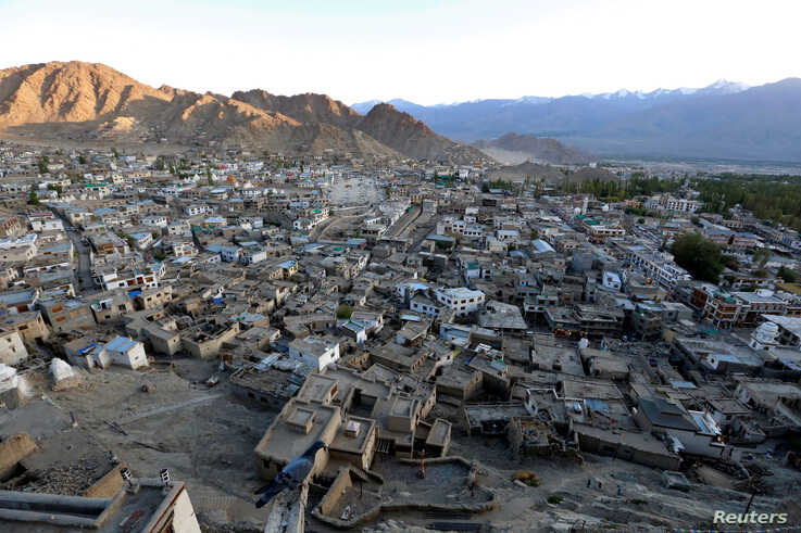 FILE - The sun sets in Leh, the largest town in the region of Ladakh, nestled high in the Indian Himalayas, India, Sept. 26, 2016.