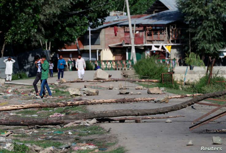 A neighborhood street is blocked with tree branches by Kashmiri protesters in Srinagar, Aug. 19, 2019.