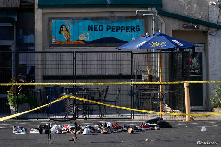 Shoes are piled in the rear of Ned Peppers Bar at the scene after a mass shooting in Dayton, Ohio.