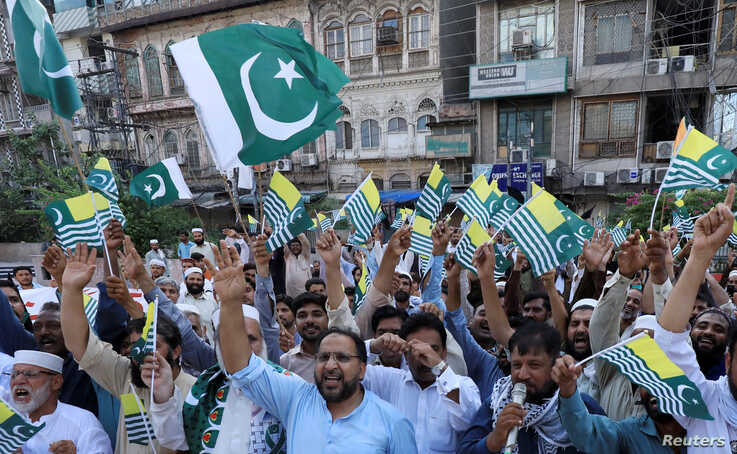 People chant slogans to observe Black Day over India's decision to revoke the special status of Jammu and Kashmir, during a protest in Peshawar, Pakistan, Aug. 15, 2019.