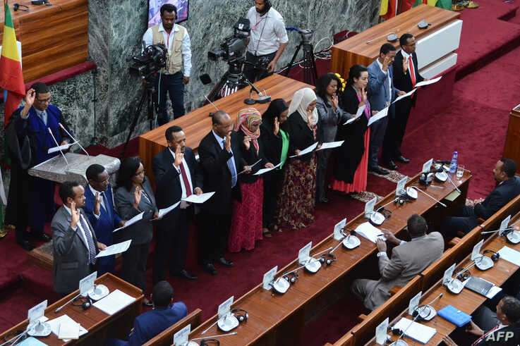 Ethiopia's newly appointed ministers take their oath of office on October 16, 2018, at the parliament in the capital Addis Ababa.
