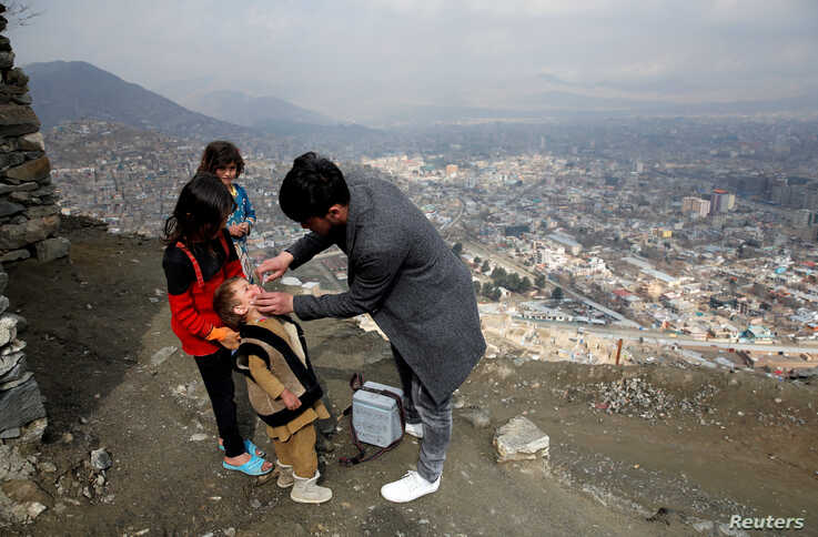 A boy receives polio vaccination drops during an anti-polio campaign in Kabul, Afghanistan, March 14, 2018.