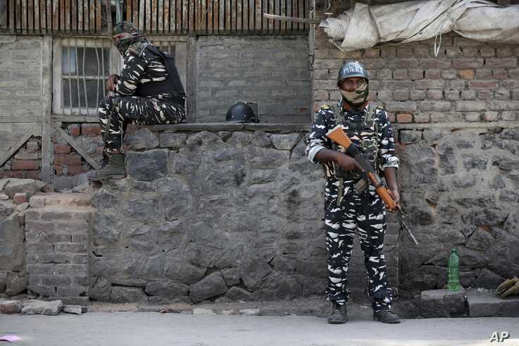 Indian paramilitary soldiers stand guard outside the main telephone exchange building in Srinagar, Indian-controlled Kashmir, Sept. 5, 2019.