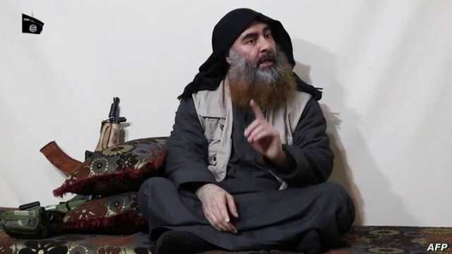 The chief of the Islamic State group, Abu Bakr al-Baghdadi, purportedly appears for the first time in five years in a propaganda video in an undisclosed location, in this undated TV grab taken from video released April 29 by Al-Furqan media.